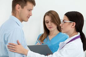 pic of empathy  - Friendly female doctor touching male patient - JPG