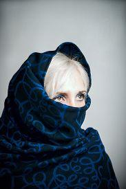 stock photo of yashmak  - Blonde girl in a blue - JPG