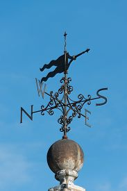 foto of wind vanes  - Wind Vane on top of an old building - JPG