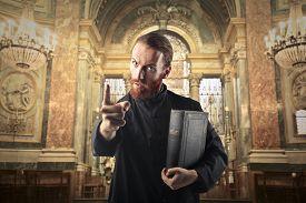 foto of priest  - Priest warning a sinner - JPG