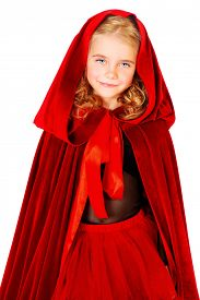 stock photo of little red riding hood  - Beautiful little girl in a red raincoat with a hood - JPG