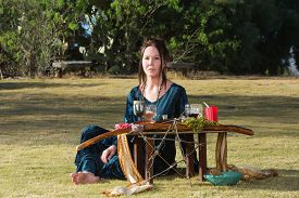picture of sabbatical  - Serious priestess in outdoor pagan altar ceremony - JPG