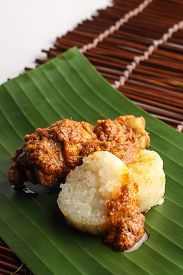 image of malay  - malay lemang served with rendang ayam on wooden background - JPG
