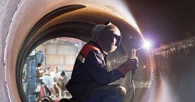 picture of welding  - The welder weld root weld from inside of the housing of chemical apparatus - JPG