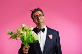 foto of nerds  - Nerd man with lipstick marks on face in Valentines Day and flowers - JPG