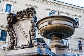 stock photo of spqr  - Old fountain with the coat of arms of ancient Rome SPQR carved in marble in Rome Italy - JPG