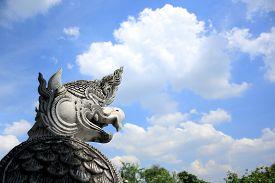 image of garuda  - Garuda statue that stands alone on a bright blue discouraged  - JPG