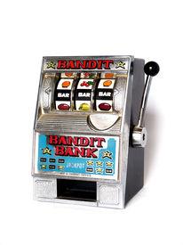 stock photo of slot-machine  - small slot machine over a white background - JPG
