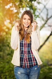 picture of denim wear  - Beautiful young blonde Caucasian woman smiling wearing fashionable autumn outfit - JPG