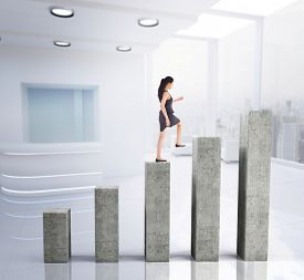 picture of step-up  - Businesswoman stepping up against bar chart depicting growth - JPG