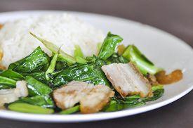 foto of crispy rice  - Stir fried kale with crispy pork and rice dish - JPG