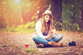 image of takeaway  - Young fashionable teenage girl with smartphone - JPG