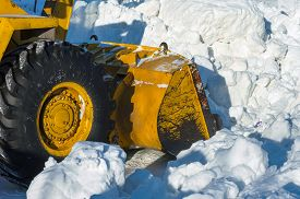 foto of dredge  - Dredge clears snow drifts after a blizzard - JPG
