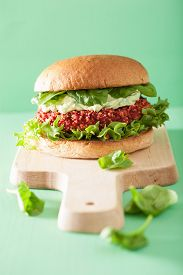 pic of veggie burger  - veggie beet and quinoa burger with avocado dressing - JPG