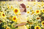 Summer Girl. Beautiful Cheerful Young Woman  With Sunflower Enjoying Nature And Laughing On Summer S poster