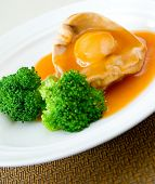 Cooked abalone and vegetable