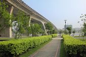 walkway and bridge,scene in a park beside a river.