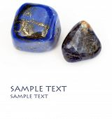 stock photo of lapis lazuli  - a couple of beautiful precious stones against white background - JPG