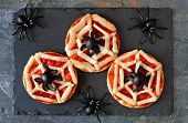 Halloween Spider Web Mini Pizzas, Overhead View On A Slate Server With Spiders poster