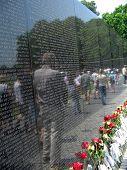 Vietnam War Memorial With Reflection Of Visitors