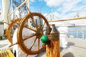 Beautiful wooden steering wheel on a big sailing ship poster