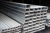 pic of ferrous metal  - Metal pipe stack on shelf - JPG
