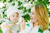stock photo of nasal catarrh  - Doctor and child during spring allergic blossom dust season - JPG