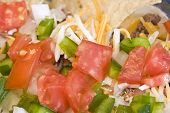 stock photo of mexican food  - close up shot of mexican bean dip bright reds and greens - JPG