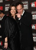 LOS ANGELES - JAN 14:  Quentin Tarantino & Date arrives to 16th Annual
