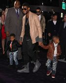 LOS ANGELES - FEB 09:  RAYMOND USHER & KIDS arrives to the