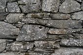 Old stone foundation. Texture of masonry. Traditional natural material in construction poster