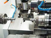 Machining Automotive Part By Cnc Turning Machine poster