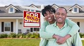 Happy African American Couple In Front of Beautiful House and Sold For Sale Real Estate Sign. poster