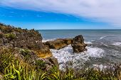 Pancake Rock is a natural wonder of Paparoa National Park. New Zealand, South Island. Scenic coastli poster