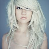 stock photo of posh  - Photo of young beautiful woman with magnificent hair - JPG