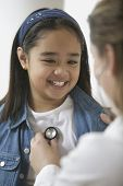 pic of soliciting  - Female doctor listening to young girl - JPG