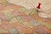Mississippi and Missouri Rivers on vintage 1920s map (printed in 1926 - copyrights expired) with a red pushpin on St Louis, selective focus