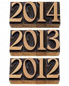incoming years 2012, 2013, 2014 - isolated numbers in vintage wood printing blocks