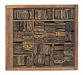 vintage wood letterpress printing blocks abstract with variety of  letters, numbers, ligature (conde