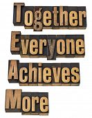 TEAM - together everyone achieves more - teamwork and cooperation concept - a collage of isolated wo