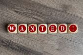 Cubes And Dice With Word Wanted On Wooden Background poster