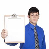 Caucasian Businessman Holding Out Blank Clipboard