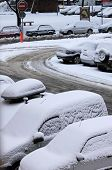 stock photo of frostbite  - A winter day with parked cars trapped under snow - JPG
