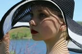 Portrait Of Pretty Young Girl Wearing A Black Hat, Outdoors, Close Up. People, Travel Concept. Prett poster
