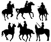 stock photo of wrangler  - cowboy riding a horse  - JPG
