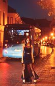 Girl With Glamour Makeup. Luxury Woman In Evening Dress At Night City Go To Prom On Bus. Fashion And poster