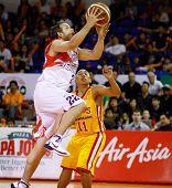 KUALA LUMPUR - FEBRUARY 19: Malaysian Dragons' Ernani Pacana (22) goes to the hoop at the ASEAN Basketball League match against Singapore Slingers on Feb 19, 2012 in Kuala Lumpur, Malaysia. Dragons won 86-71.