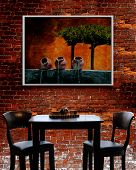 French Bistro - table, chairs with brick background. Image on wall is also a Shutterstock image.