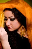 Beautiful young woman in color arabian clothes