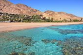 Horizontal oriented image of beautiful Red Sea shoreline and red mountains in Eilat, Israel.